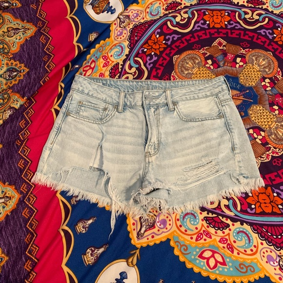 American Eagle light wash distressed jean shorts.